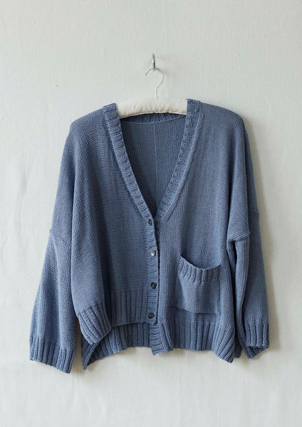 This knitting pattern is for an oversized assymetrical cardigan designed by Erika Knight and knitted in her Studio Linen.