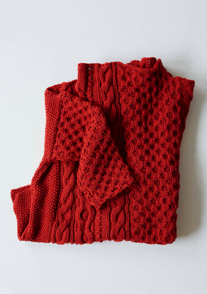 Caravan is a modern aran stitch sweater designed by Erika Knight and knitted in her Gossypium cotton. Available as a kit from The Knitter's Yarn.