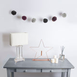 Beautiful pompom garland available in a kit from The Knitter's Yarn.