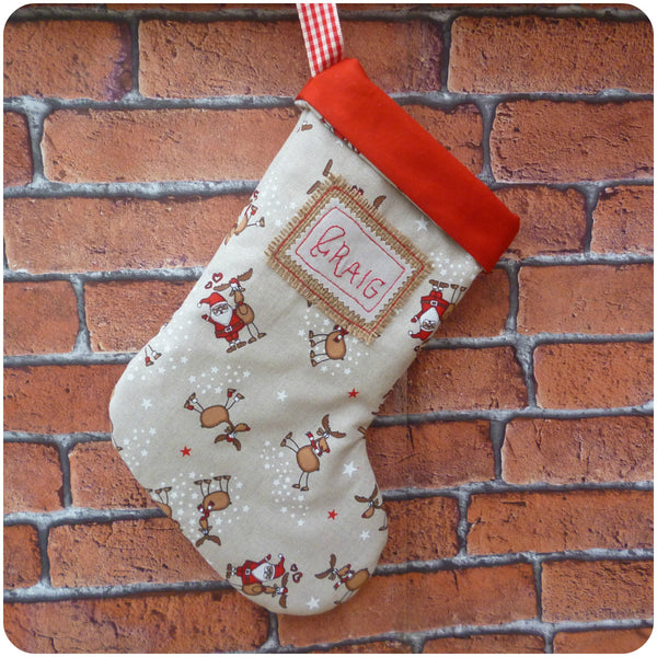 Personalised Santa Stocking, Father Christmas and Reindeer fabric with red linen lining, front view