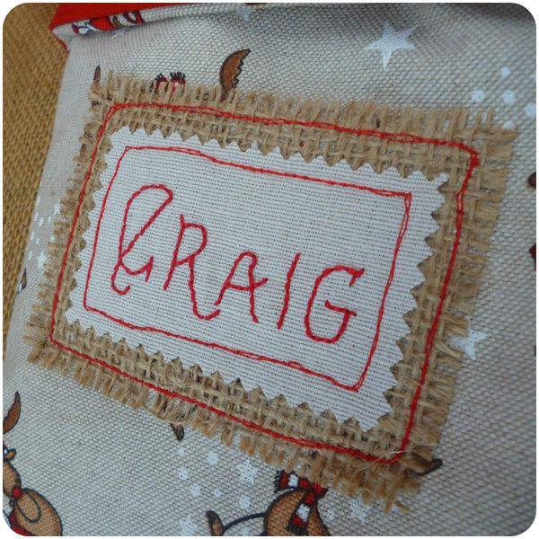 Personalised Santa Stocking, embroidered name patch close up