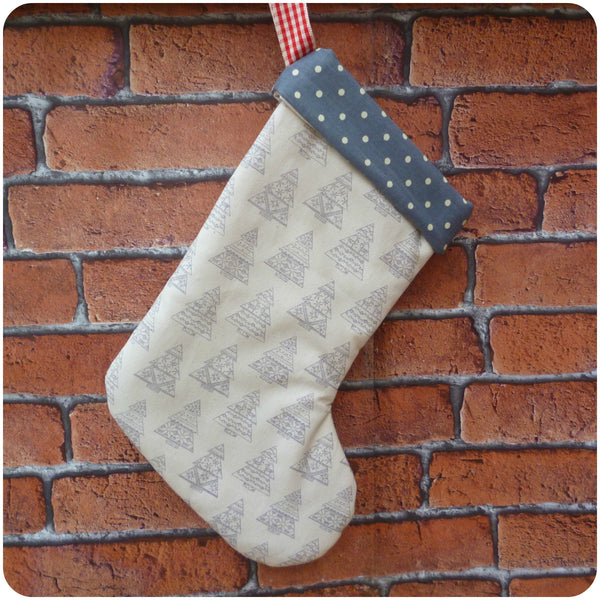 Personalised Nordic style Christmas stocking, cream Christmas tree fabric with grey polka dot lining, front view