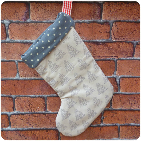 Personalised Nordic style Christmas stocking, cream Christmas tree fabric with grey polka dot lining, back view