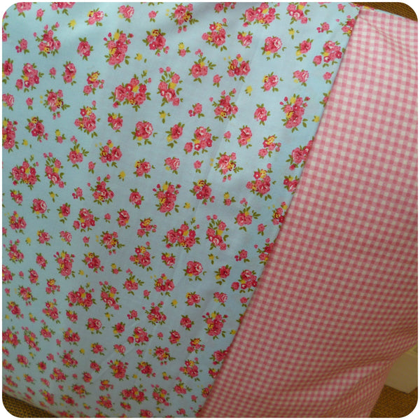 Alice in Wonderland Flamingo Cushion Back close up, envelope opening with blue floral and pink gingham fabrics