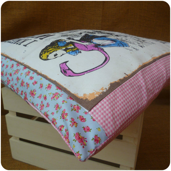 Alice in Wonderland Flamingo Cushion, view from edge close up, blue floral and pink gingham fabrics