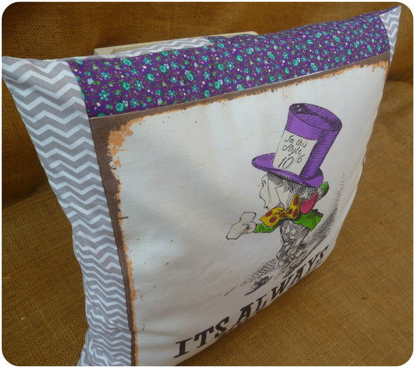 Alice in Wonderland The Mad Hatter Cushion, Front view, illustration with purple floral and grey chevron fabric borders close up