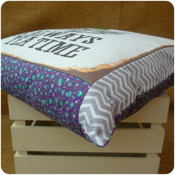 Alice in Wonderland The Mad Hatter Cushion, corner view of purple floral and grey chevron border fabrics close up
