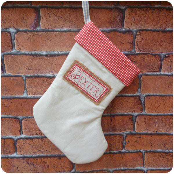 Personalised calico Christmas stocking with red gingham lining, front view
