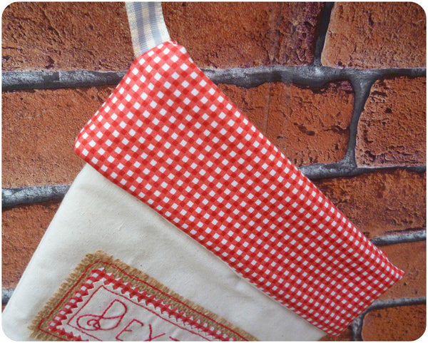 Personalised calico Christmas stocking, close up of red gingham cuff
