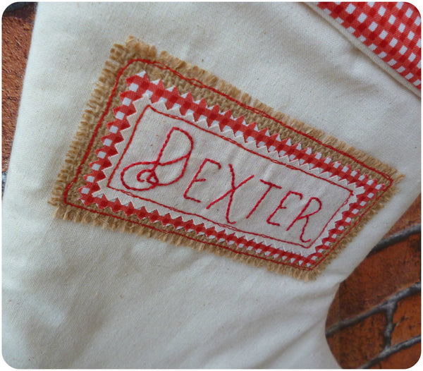 Personalised calico Christmas stocking, close up of name embroidery on hessian patch
