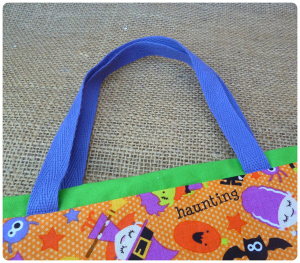 Spooky Halloween Goodie Bag, Purple Handles Close Up