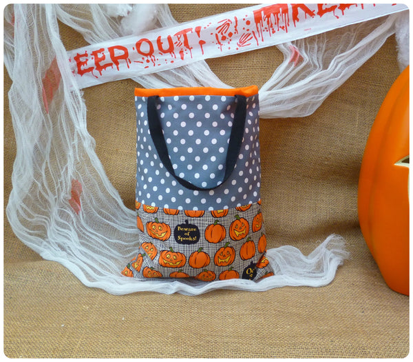 Personalised Pumpkin Treat Bag Back View, Grey Pumpkin fabric, Grey polka dot, black handles, orange lining.
