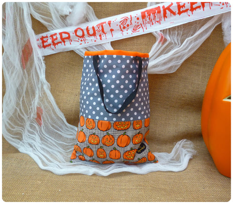 Personalised Pumpkin Treat Bag Front View, Grey Pumpkin fabric, Grey polka dot, black handles, orange lining.