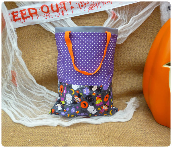 Personalised Halloween Treat Bag Back View, Grey Halloween Costumes fabric with purple polka dot and orange handles