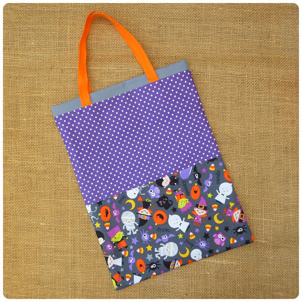Personalised Halloween Trick or Treat Bag, Flat Lay of Purple Polka Dot and Grey Halloween Costumes Fabric Bag