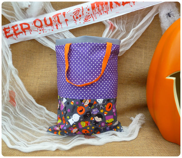 Halloween Treat Bag Front View, Grey Halloween Costumes fabric with purple polka dot and orange handles