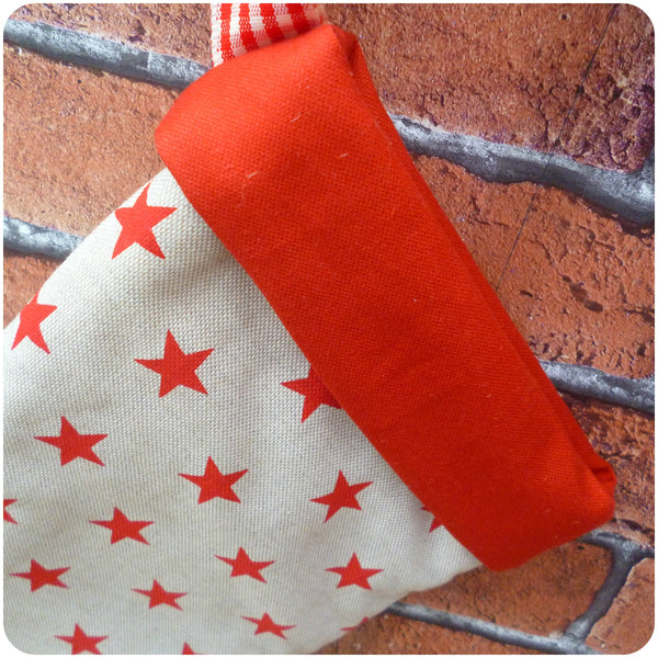 Personalised Christmas Stars Stocking, red stars fabric, red cuff close up