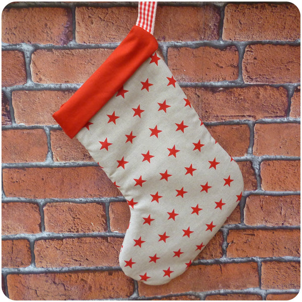 Personalised Christmas Stars Stocking, red stars fabric with red lining lining, back view