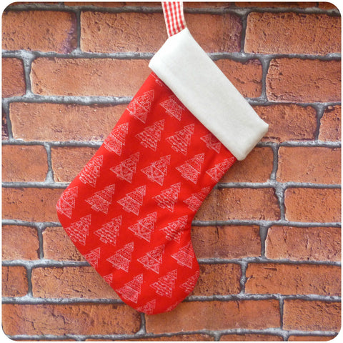 Personalised red Scandi style Christmas stocking with cream lining, front view