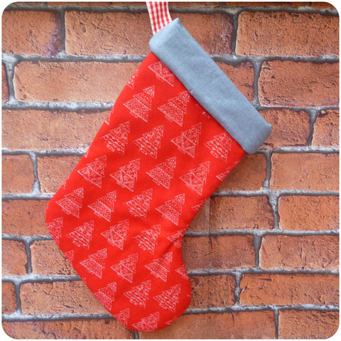 Personalised Scandinavian style Christmas stocking, red tree print fabric with grey lining, front view