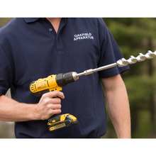 heavy duty auger in hands with drill