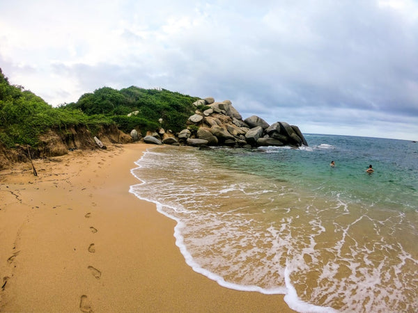 Relaxing at Cabo San Juan in Tayrona National Park, Colombia after our muddy jungle trek.