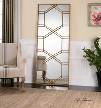 Oversized antiqued gold leaf mirror