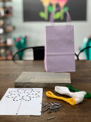 Your Kids' String Art Craft Kit includes one board, one stencil, nails, string and instructions!
