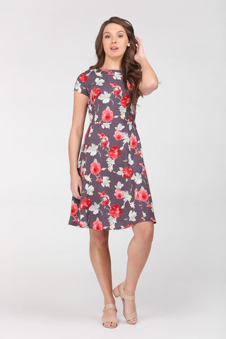 A floral pattern dress by Ambi with full A-line skirt. Featuring medium red flowers on a muted mauve background.