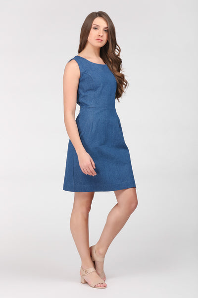 A classic indigo denim sheath dress by Ambi. Side view.