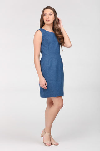 A classic indigo denim sheath dress by Ambi. Side front view.