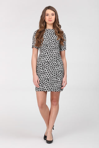 Sheaf mini dress by Ambi. Black and white pattern featuring small white circles over a black background. Front.