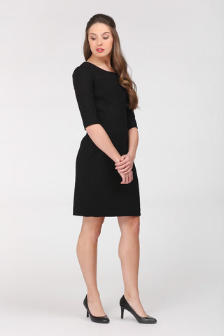 Little black dress by Ambi - 100% wool. Richly textured fabric. Side front view.