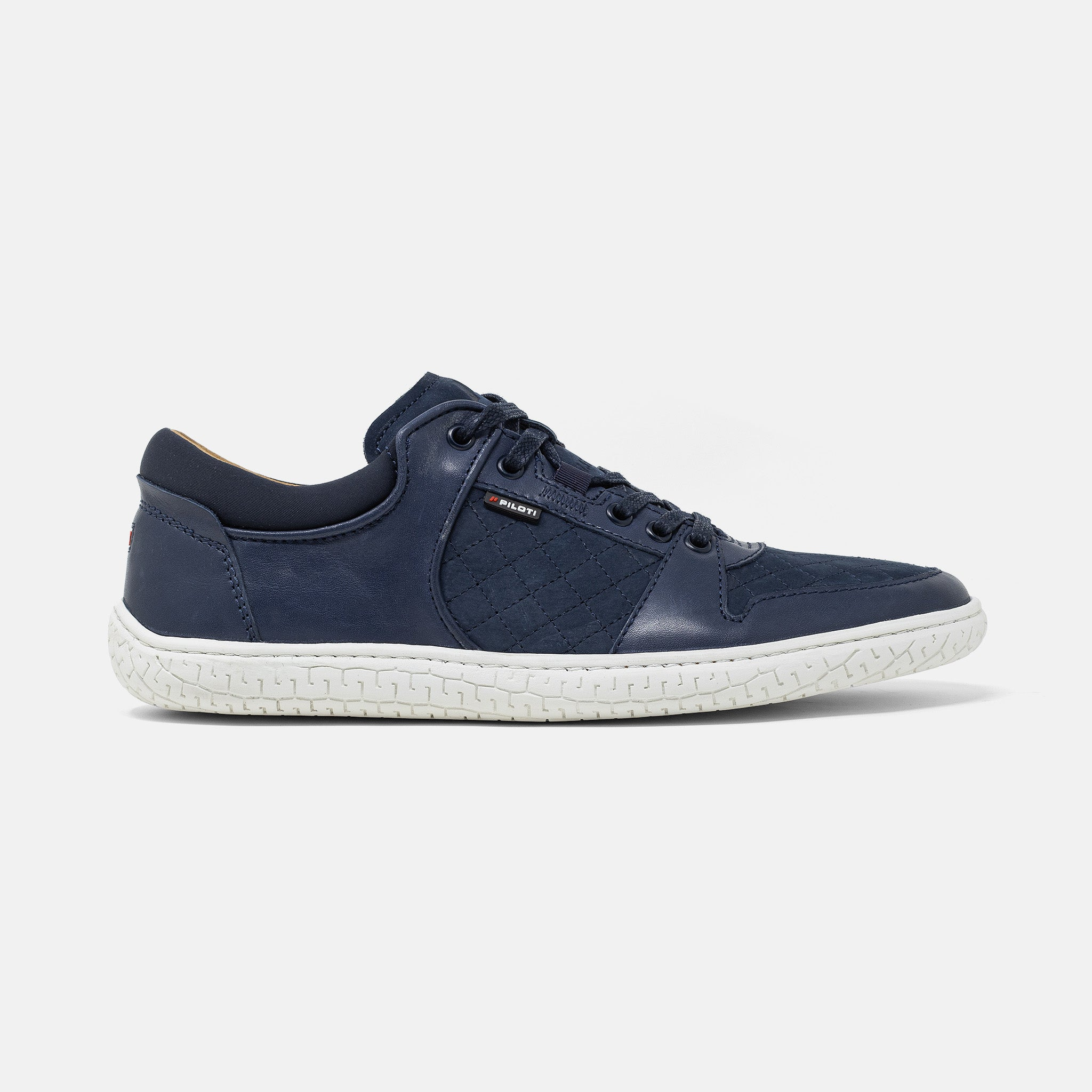 Men's navy leather and suede Momentum sneaker with white cup sole, lateral view