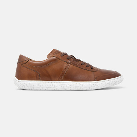 Men's cognac brown burnished leather Avenue low top sneaker with white cupsole and brogue detailing, lateral view