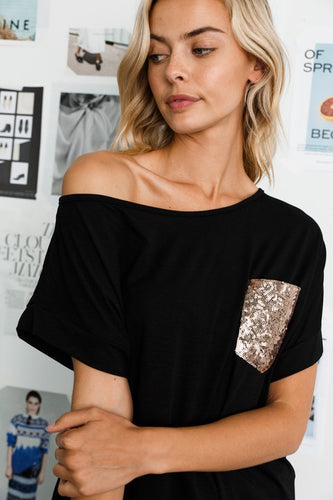 Off shoulder tunic top with sequin pocket
