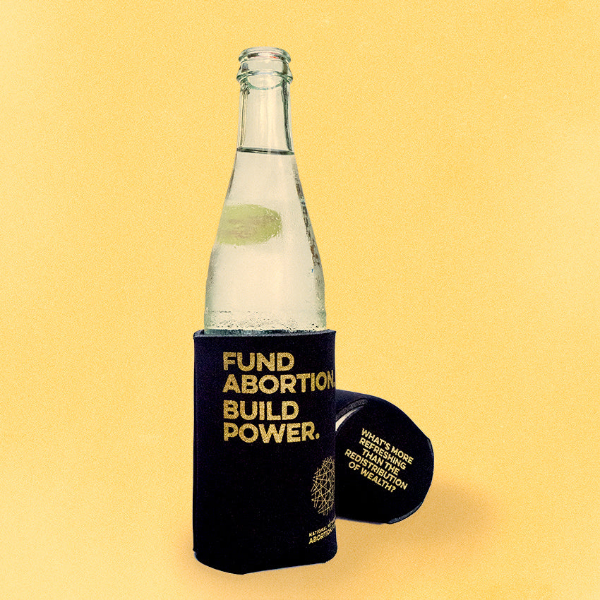 Photo of a clear glass bottle in a black koozie, on a yellow background. The koozie is imprinted with the text,