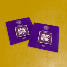 "Photo of two enamel lapel pins reading ""END HYDE,"" affixed to purple cards reading ""NOW!"" so that the full message reads ""END HYDE NOW!"" The pins are square, made of gold metal with eggplant purple enamel. The tops of each card feature the National Network of Abortion Funds logo."