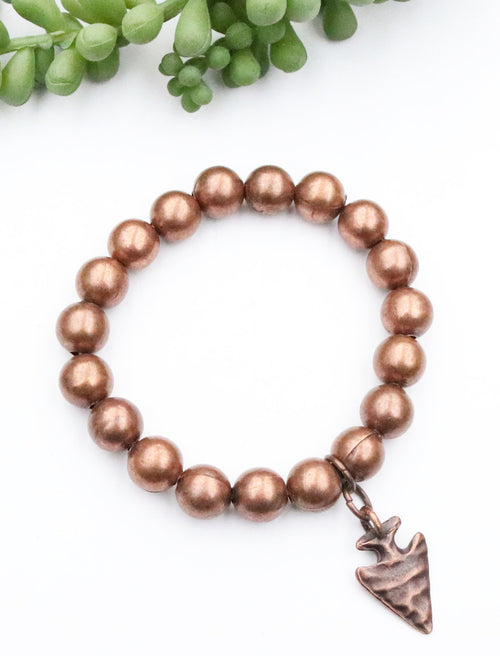 Storefront - matte copper stretch bracelet with arrowhead charm