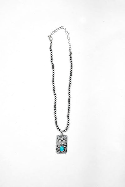 Storefront - Dainty faux Navajo pearl necklace with thunderbird charm