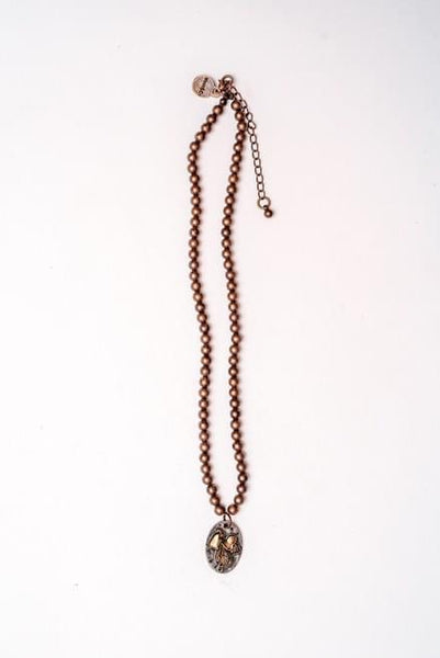 Copper saddle charm necklace