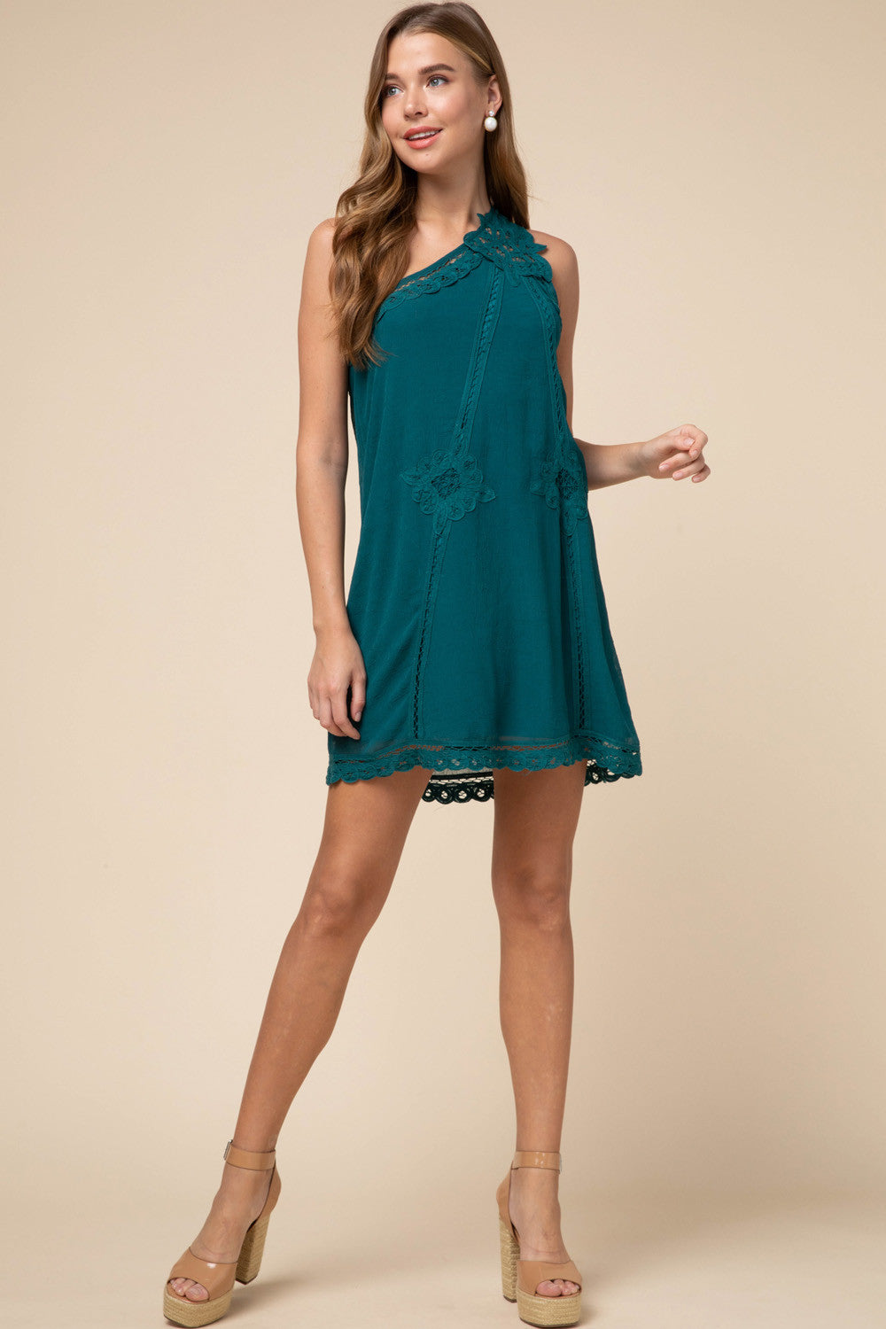 One-shoulder dress featuring crochet lace trim detail