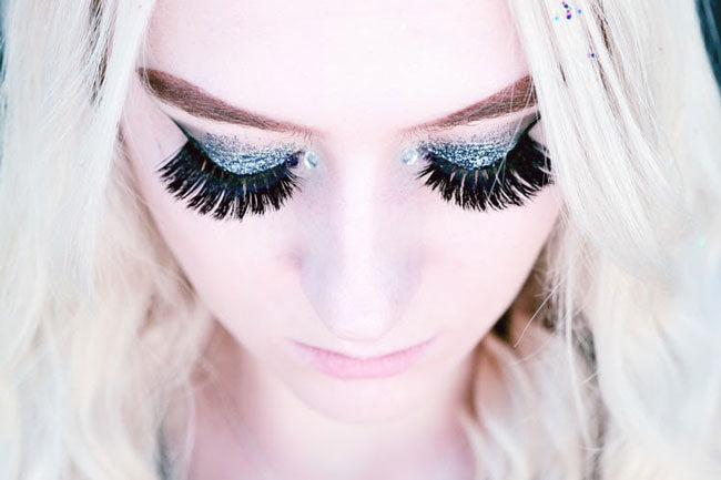 a woman with thick fake eyelashes