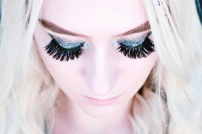 woman with lash extensions and makeup
