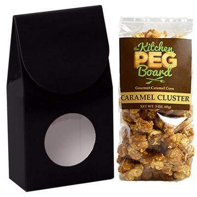 Black, Themed, Treat Box Filled with a 3-oz. Bag of Gourmet Caramel Popcorn From The Kitchen PEG Board.