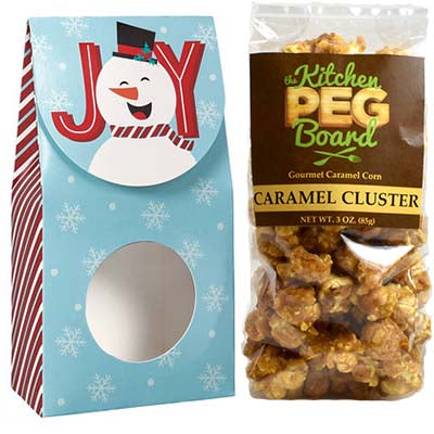 Joyful Snowman, Themed, Treat Box Filled with a 3-oz. Bag of Gourmet Caramel Popcorn From The Kitchen PEG Board.
