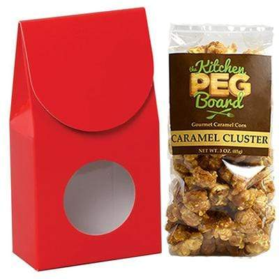 Red, Themed, Treat Box Filled with a 3-oz. Bag of Gourmet Caramel Popcorn From The Kitchen PEG Board.