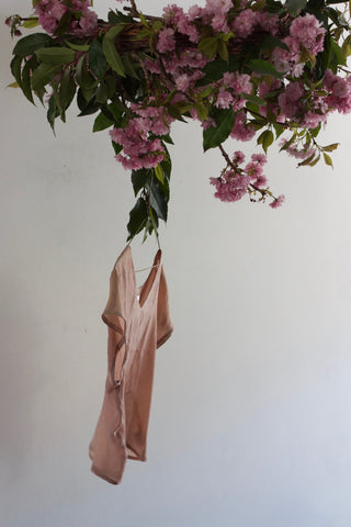 Daisy Fung flower installation with hanging shirt