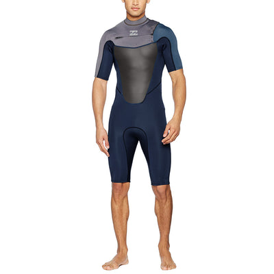 A gray Billabong shorty wetsuit with 2mm neoprene and a chest zip entry.A gray Billabong shorty wetsuit with 2mm neoprene and a chest zip entry.