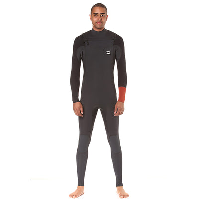 A gray Billabong wetsuit with a rust colored sleeve detail, chest zip entry and 3/2mm neoprene.